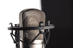 Studio microphone on the stand. Studio microphone and microphone stand on white background stock photography