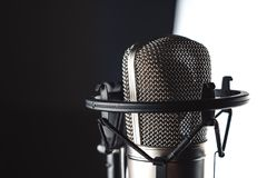 Studio microphone on the stand. Studio microphone and microphone stand on white background royalty free stock photo