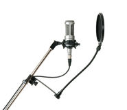 Studio microphone with pop filter, isolated Royalty Free Stock Photos