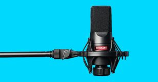 Studio microphone for recording podcasts. Over blue background royalty free stock images
