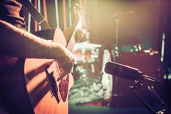 The Studio microphone records an acoustic guitar close-up. Beaut. The Studio microphone records an acoustic guitar close-up, in a recording Studio or concert stock image