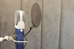 Studio microphone. In studio room for voice record Royalty Free Stock Images