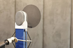 Studio microphone. In studio room for voice record Royalty Free Stock Photos