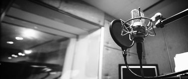 Studio microphone with shock mount and pop filter royalty free stock photography