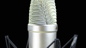 Studio Microphone with Spider Rotates on a Black Background stock video