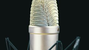 Studio Microphone with Spider Rotates on a Black Background stock video footage