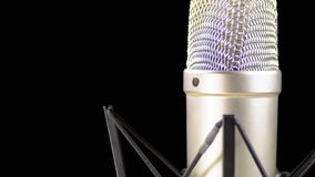 Studio Microphone with Spider Rotates on a Black Background stock footage