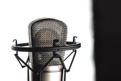 Studio microphone on the stand. Studio microphone and microphone stand on white background stock images