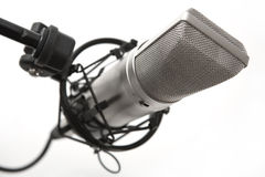 Studio mike. A studio condenser microphone in shock proof cage, isolated on a white background Royalty Free Stock Photos