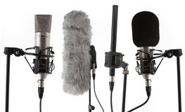 Studio mikes. 4 studio condenser microphones on stands Royalty Free Stock Photo