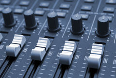Studio Mixing Desk. Up-close. Showing sliders and knobs Royalty Free Stock Photography