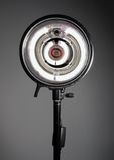 Studio monolight. Firing towards camera with gray backdrop stock photography