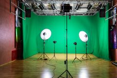 Studio for movies. Green screen. The chroma key. Lighting equipment in the pavilion. Show business royalty free stock images