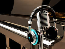 Studio Music. A microphone and headphones in the foreground of a great piano Stock Image