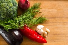 Studio photo of different vegetables on wooden table stock image