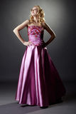 Studio photo of majestic blonde in pink dress Stock Images