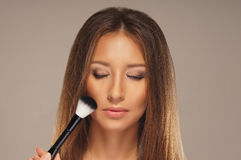 Studio photo of a make-up process Royalty Free Stock Photography