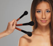 Studio photo of a make-up process Stock Photos
