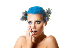 Studio photo surprised girl with flowers in her hair and multico Stock Photo