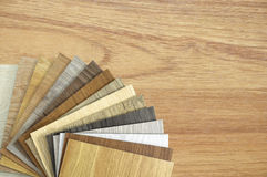 A studio photo of timber laminate flooring.laminate floor plank. Samples of laminate and vinyl floor tile on wooden Backgroundisolated on white background.wood Royalty Free Stock Photography