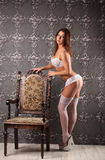 Studio photo of vintage sexy young woman, white lingerie Royalty Free Stock Photo
