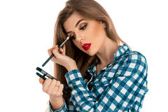 Studio photo of young beauty makeup artist on white background Stock Images