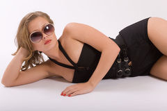 Studio photographing. Portrait of the beautiful girl in points royalty free stock photos
