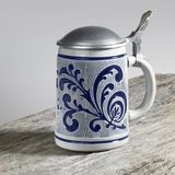 Blue decorated stein on wooden surface Stock Image