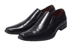 Pair of dark shoes Stock Photography