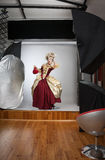 Studio photoshooting with beautiful woman Royalty Free Stock Photos