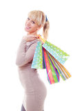 Studio picture of beautiful woman with bags stock photo