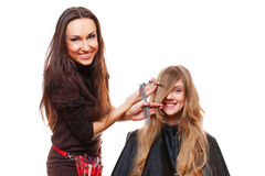 Studio picture of hairdresser doing haircut Royalty Free Stock Image