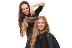 Studio picture of hairdresser and smiley woman Royalty Free Stock Photo
