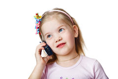 Studio picture from a little child with cell Royalty Free Stock Photography