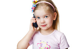 Studio picture from a little child with cell Royalty Free Stock Photos