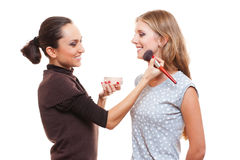 Studio picture of make up artist and young woman Royalty Free Stock Image