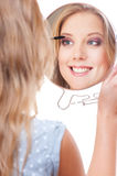 Studio picture of smiley young woman with miror Royalty Free Stock Images