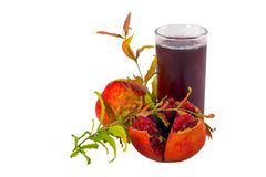 In studio. Pomegranate and juice on white background. With copy space stock images