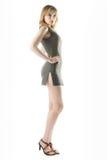 Studio portrait. Full length shot of blond girl in dress royalty free stock photos