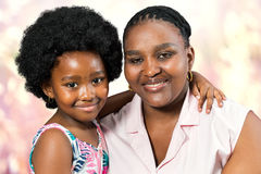 Studio portrait of african mother and little daughter. royalty free stock photography