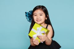 Studio portrait of asian girl happily receiving a gift Stock Photography