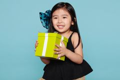 Studio portrait of asian girl happily receiving a gift Stock Photo
