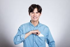 Studio portrait of an asian man holding a card. Shot Royalty Free Stock Photography