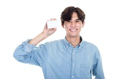 Studio portrait of an asian man holding a card. Shot Royalty Free Stock Images