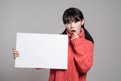 Studio portrait of 20 Asian women surprised holding billboards Royalty Free Stock Photography