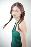 Studio portrait of attractive girl in green outfit Stock Photography