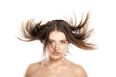 Attractive young girl withh windy hair. Studio portrait of attractive young caucasian girl with messy hair Stock Photo