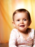Studio portrait baby. Adorable girl setting on colorfull background Royalty Free Stock Photography