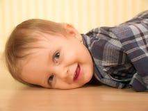 Studio portrait baby. Adorable girl laying on the floor Stock Photo