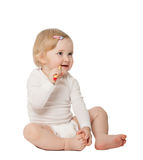 Studio portrait of a baby cleaning her teeth Stock Photography